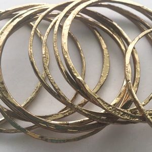 Jewelry - Set of 12 gold tone hammered look bangle bracelets